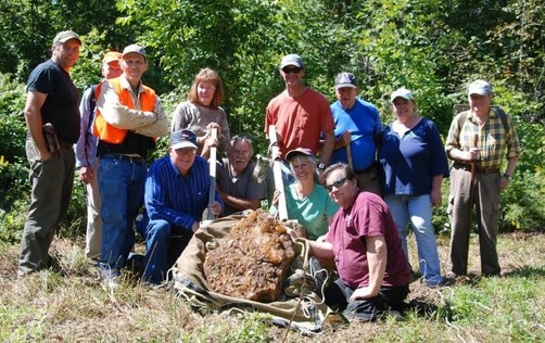Jenn Barton, John Scarinza, and David Willcox of the Randolph Community Forest are joined by members of the Presidential Gem and Mineral Society, during the recovery of a large plate of crystals that were taken from the mine.