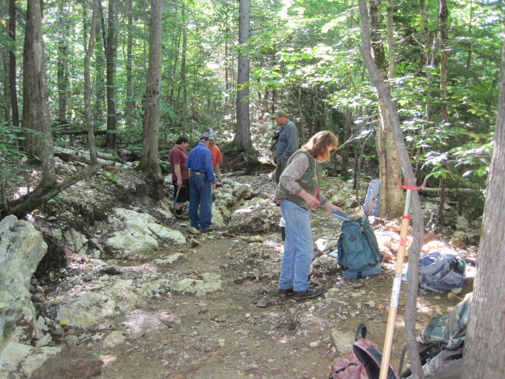 Members of the Presidential Gem and Mineral Society on a recent trip to the Randolph Town Forest crystal mine.