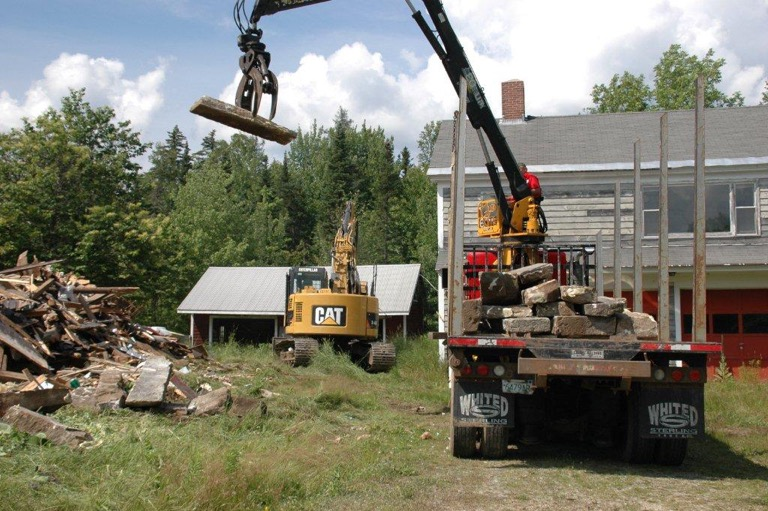 The site of the former Farrar homestead, on Route 2-- and some granite being moved to the remote Pond of Safety.