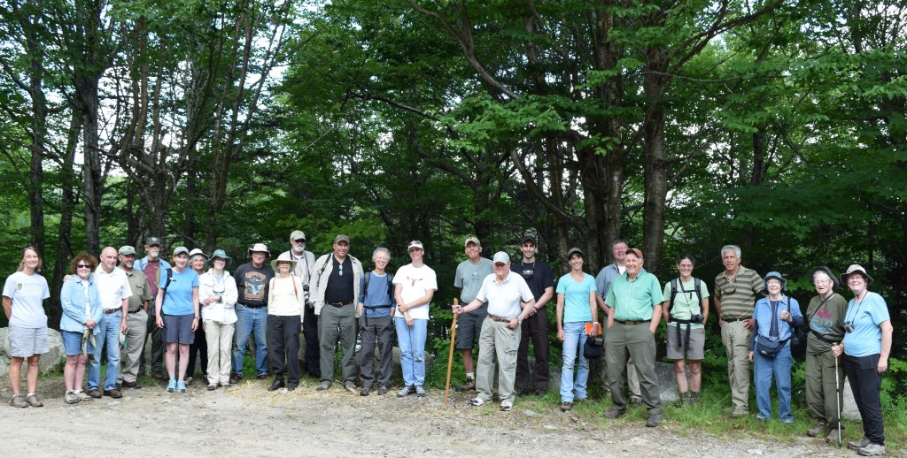 Many of the 35 participants in the Aug. 1 Randolph Community Forest Day tour posed for a photo in the parking lot near the Pond of Safety, located in Randolph some 5 miles from Route 2 on the Kilkenny Unit in Androscoggin Ranger District of the White Mountain National Forest. (Photo by Edith Tucker.)