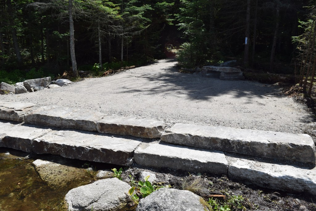 This photo of the granite steps at the remote Pond of Safety that drains north to the Upper Ammonoosuc River watershed was shot from one of the temporary hay bales that will be removed once the possibility of erosion and sedimentation has passed. It took time, patience and skill for each slab to be put securely in place. (Photo by Edith Tucker.)