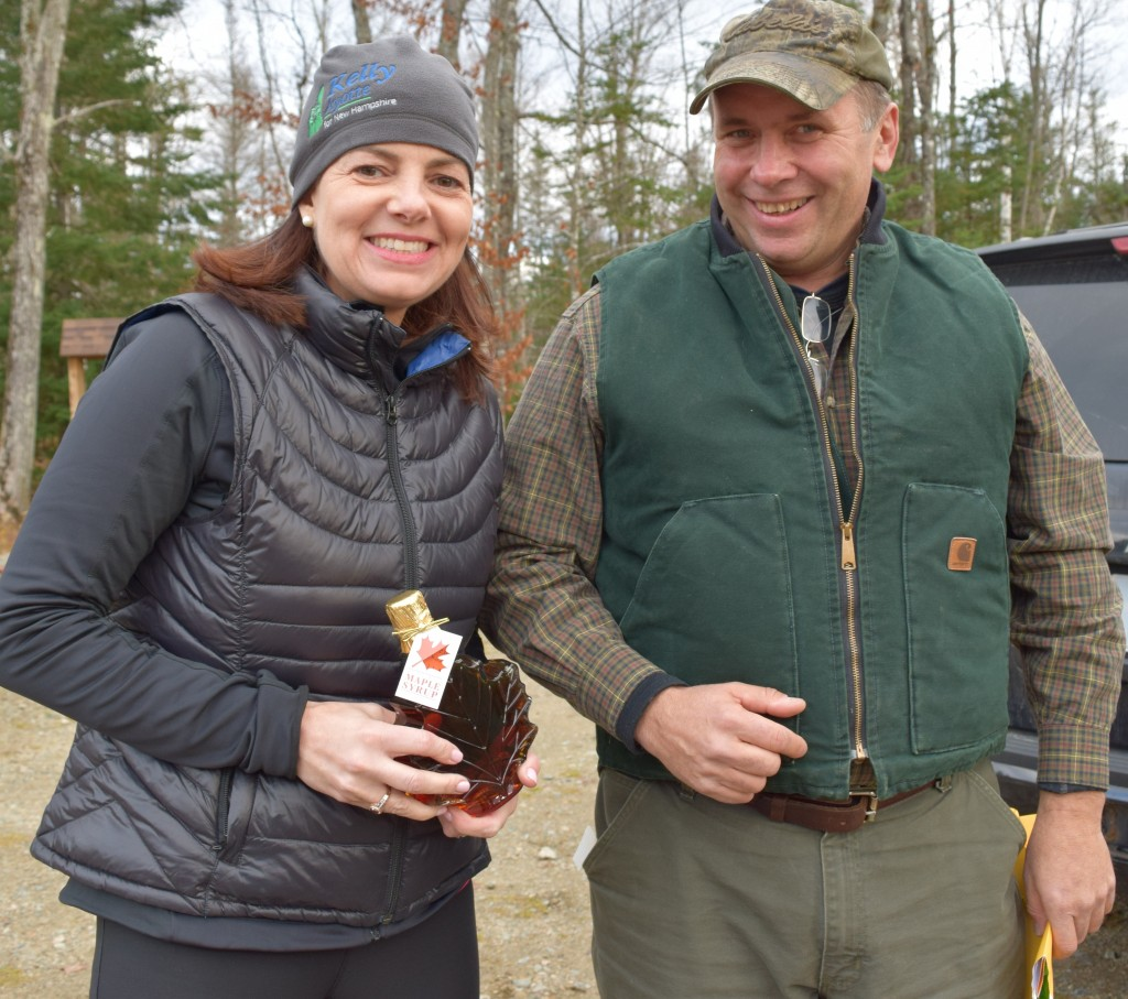 John Scarinza, Chair of the Randolph Community Forest Commission, presented US Senator Kelly Ayotte with maple syrup from his sugar bush.