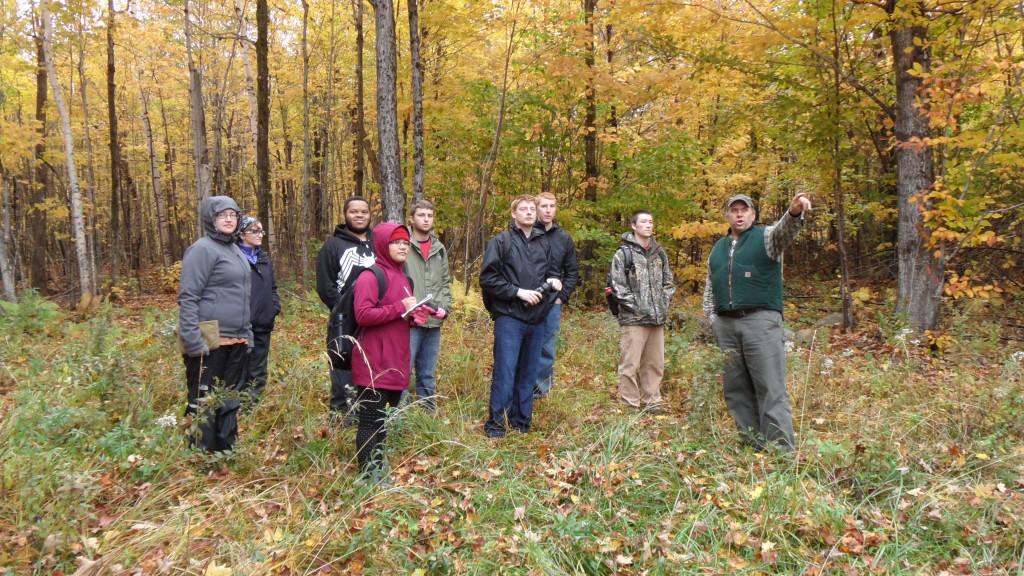 Forest Commissioner John Scarinza explains Randolph Community Forest management projects to Plymouth State University students, October, 2015.