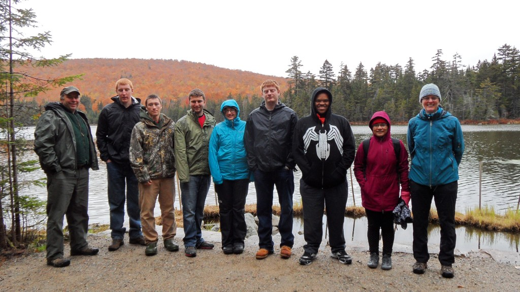 John Scarinza (left) and June Hammond Rowan (right) with Plymouth State University's Land Conservation Techniques class at Pond of Safety.
