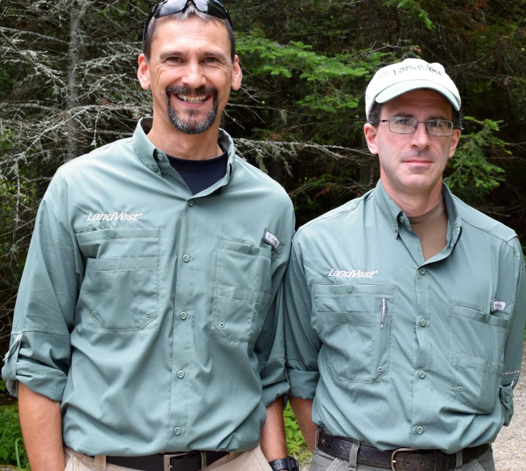 John Steward, left, of its West Stewartstown office and David Degruttola of Bethel, Me. — the new LandVest, Inc. Randolph Community Forest forestry team — were introduced to the community on Aug. 6. (Edith Tucker photo)